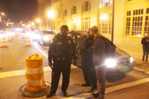 Hinson and another officer talk to Baskerville when demonstrators blocked Elm St.