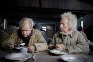 Allan (left) and Herbert Einstein feast in a Soviet gulag.